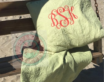 Quilted queen coverlet with Two Monogrammed Euro pillow shams.