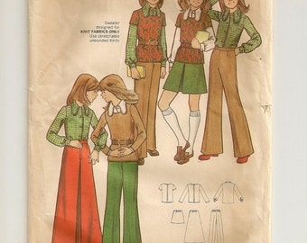 """A Long Sleeve Shirt, Close-Fitting Top, A-Line Inverted Pleat Skirt & Flared Pants Sewing Pattern: Girls Size 8, Breast 27"""" • Butterick 6826"""