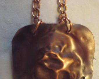 Copper pendant on copper chain with lobster closing