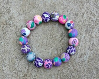 Purple and pink floral clay bead bracelet, handmade, polymer clay beads, art deco bracelet, 7 in, gift for her, girls bracelet, womens