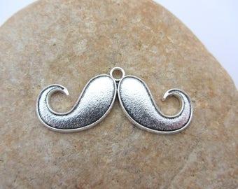 A charm, a pendant, a big mustache, of color silver