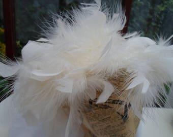 Ivory swirly feathery hat