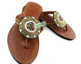 Beautiful handmade beaded leather sandals in gold and white