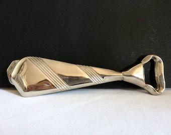 Original silver metal bottle opener, tie