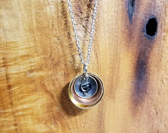 Mixed metal pendant on 18 inch chain