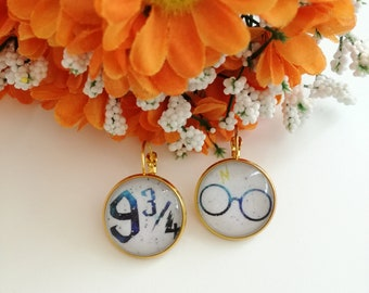 Harry potter paper earrings with gold cameo pendant.