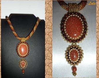 beautiful necklace with embroidered cabochons of aventurine