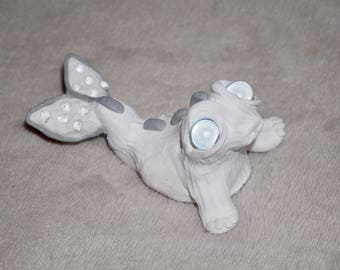 Handmade polymer clay mythical sea creature sculpture with shiny pearl eyes