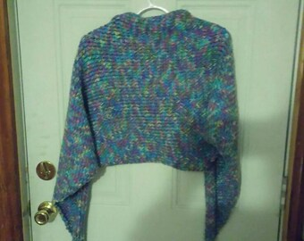 Hand knit purple variegated yarn shawl.