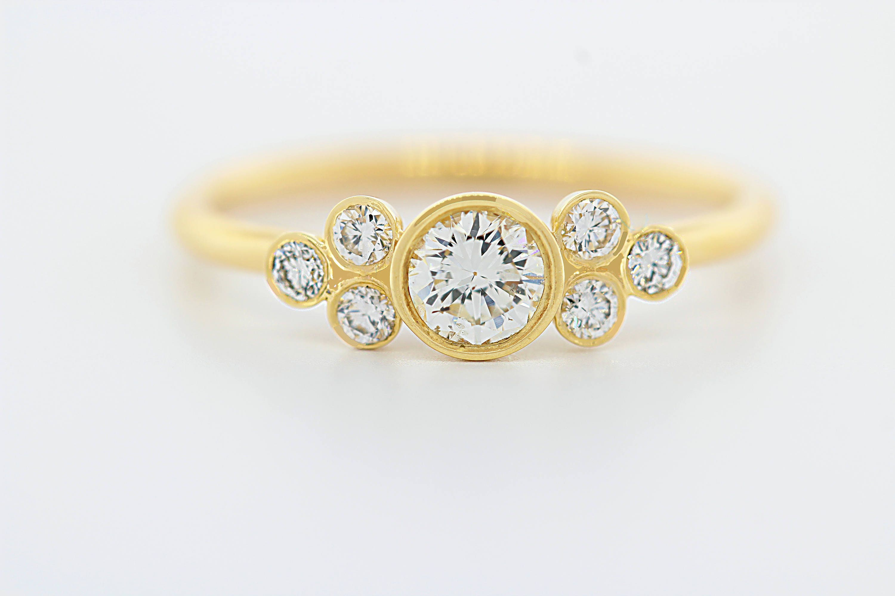 halo setting rings thin diamond carat appearance the ringgold bands pin pairing with gold ring a s highlights large engagement white robust band in