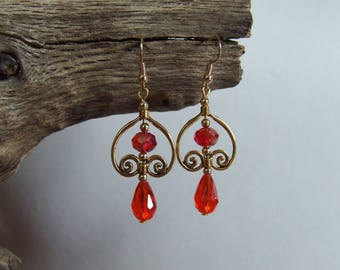 Inspiration earrings 19th century backed arabesque golden orange-red faceted glass beads