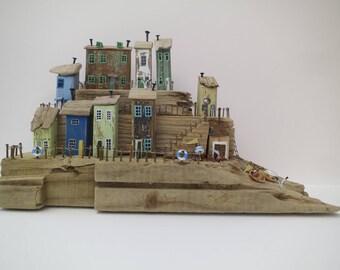 Driftwood sculpture of fishing village- Statement piece.