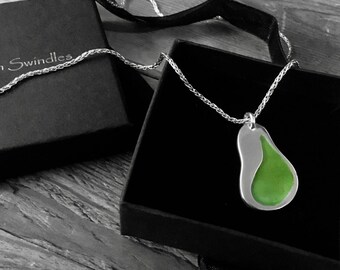 Silver pendant with light green enamel