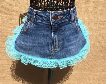 Denim apron with blue lace and a polka dot grosgrain ribbon tie