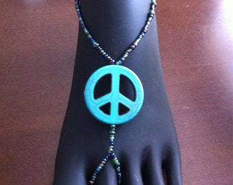 Multi-colored barefoot sandal with peace sign