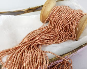 Antique gold metal strand of seed beads size 13
