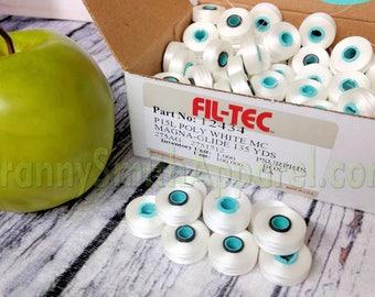 Magnetic core bobbins. Fil-Tec Magna-Glide Classic Embroidery Machine prewound Bobbins. Type / Class / Style L. Filament Polyester No. 60