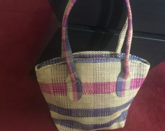 Purple and tan raffia handbags