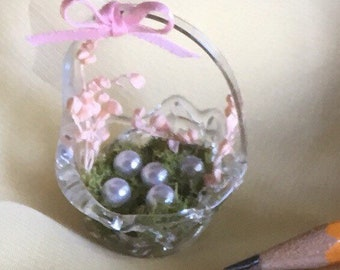 Miniature easter basket with pearl eggs