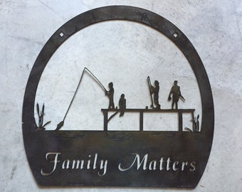 Custom metal sign with Fishing family on dock