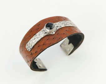 textured leather cuff with black onyx set in silver
