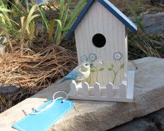 Hand-painted birdhouse with bird
