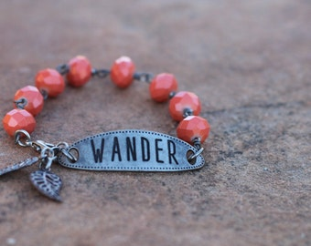 "Coral Salmon Colored Wire Wrapped Bracelet with ""Wander"" tag and leaf dangle charms"