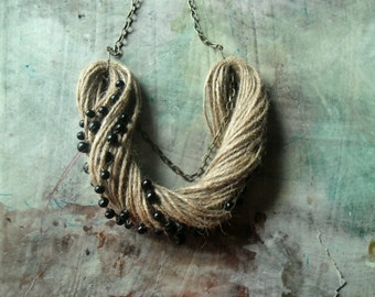black stones.... natural rope statement necklace sea beach ocean sand net fisher raw wild wind wood beads chain metal bronze modern rustic