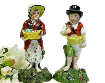 A Pair of Early 19th Century Pearlware Staffordshire Street Vendor Figurines