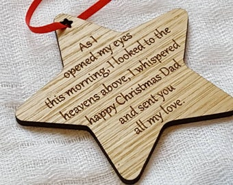 Wooden Christmas tree decorations with words to remember loved ones at Christmas.