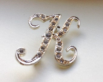 Initial K pin with rhinestones.