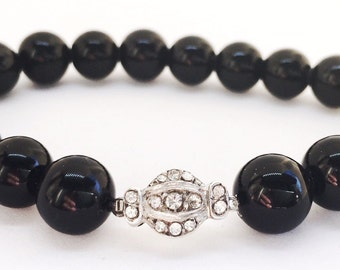 Antique vintage Art Deco beaded bracelet, onyx with sterling silver and rhinestone clasp