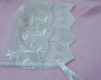 A Pretty Ivory Lace Baby Bonnet in various sizes.