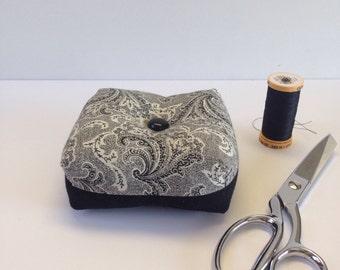 Square, box shaped black and white pincushion, pin holder