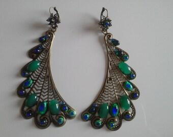 long dangle earrings: the Peacock