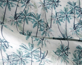 Off white palm tree and dark turquoise blue pineapple pattern cotton Voile.