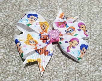3 inches bubble guppies pin wheel hair bow on a non slip alligator clip