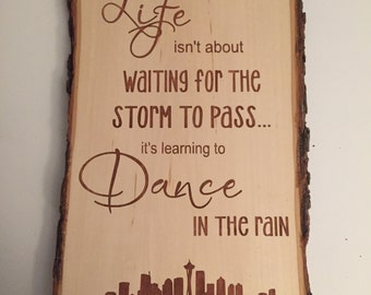 life isn't about waiting...learning to dance in the rain sign