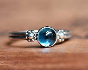 London blue topaz ring, blue gemstone ring, December birthstone ring, silver flower ring, daisy ring, cabochon ring, boho rings, size 5.5