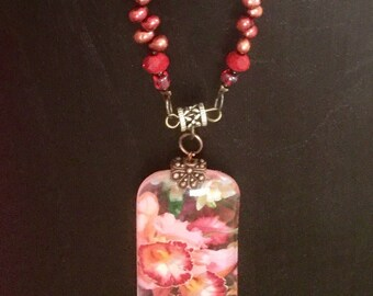 Pink Cattleya Orchid Pendant Necklace with Burgandy Pearls, Ruby Red Roundelle Beads & Red Lampwork Discs by Denise's Creations