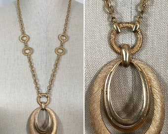 70s Crown Trifari Gold Oval Medallion Long Chain Pendant Necklace