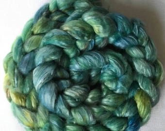 Hand-dyed green combed for spinning