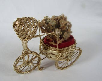 Vintage perfume bottle holder bicycle riding flower seller