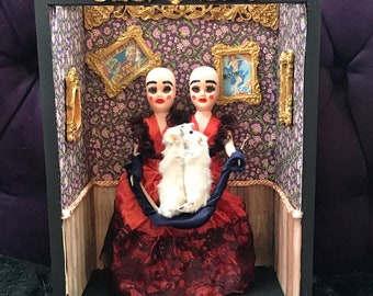 Conjoined twins taxidermy art. Freakshow conjoined Siamese twins in carnival sideshow w/ mice