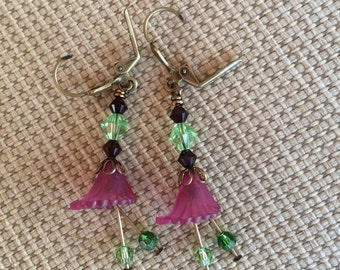 Adorable purple lucite flower dangle earrings with swarovski crystal accents.