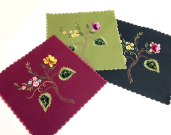 "Unusual Victorian felt table mat known as a Tidy. 17"" square, with scalloped edges, floral appliqué and embroidery. In 3 colors."