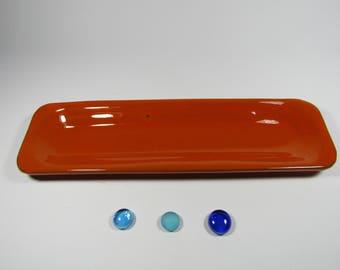 Terra cotta orange spoon rest