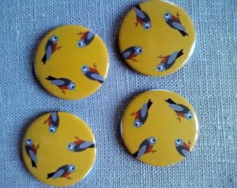 Button magnets round birds mustard background