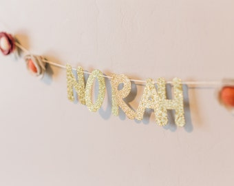 custom gold glitter name banner with felt flowers
