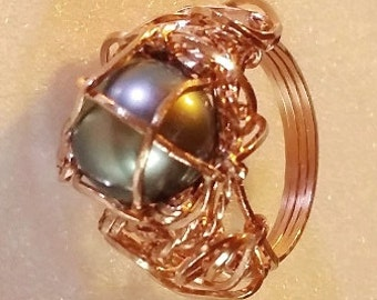 TALL ring. Genuine South Sea pearl is undrilled and caged in rose gold filled wrap to create this OOAK ring.  Pearl is 11 mm diameter.